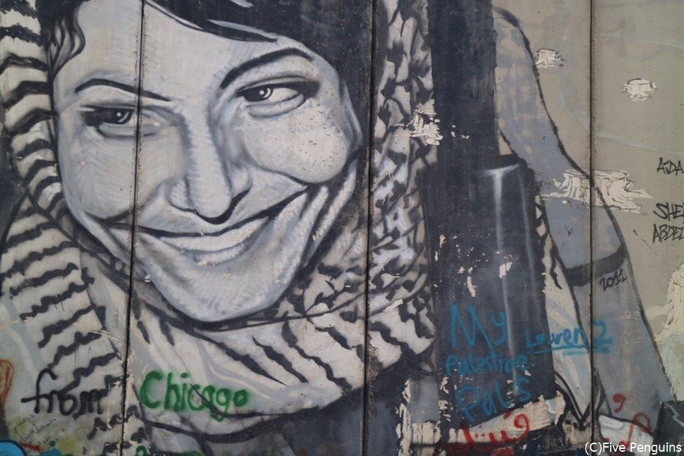 パレスチナ分離壁に描かれた絵